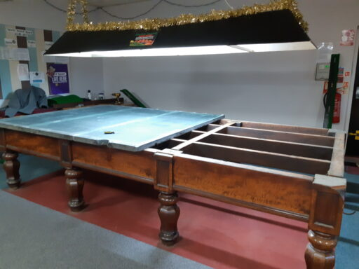 Partially dismantled snooker table